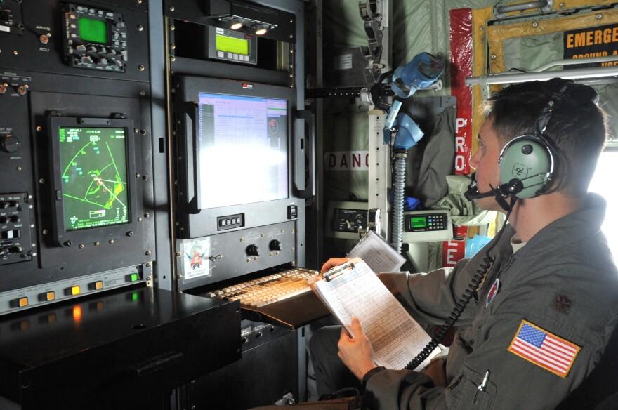 Maj. Jeremy DeHart, a 53rd Weather Reconnaissance Squadron aerial reconnaissance weather officer, reviews data from Hurricane Michael.