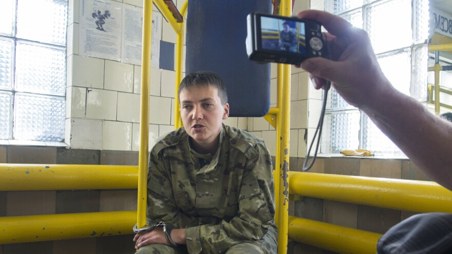 Ukrainian military officer Nadezhda Savchenko speaks to journalists shortly after her capture in Luhansk, Ukraine, on June 19, 2014. She was apparently captured by pro-Russian insurgents during fighting in eastern Ukraine. But she is being held in Russia, which claims she was arrested in that country. Ukrainian officials say the separatists handed her over to Russia.