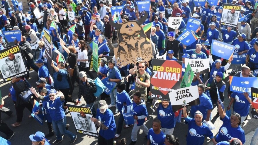 Supporters of the opposition Democratic Alliance march against President Jacob Zuma ahead of the motion of a no confidence vote against him in Cape Town, South Africa.