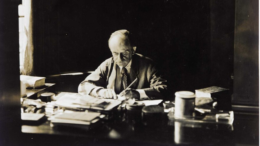 J.M. Barrie, at work at his desk in an undated photograph.