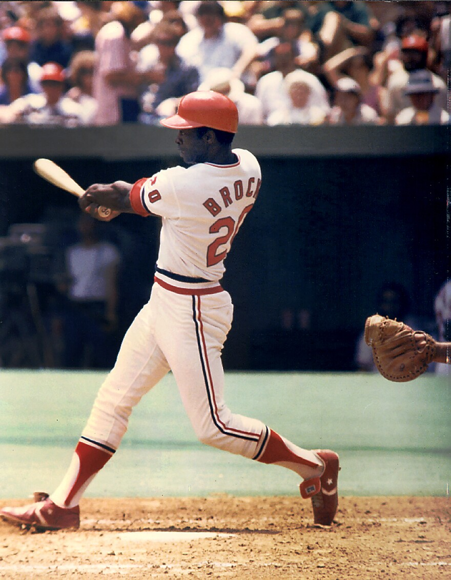 Lou Brock following through on a swing after hitting the ball