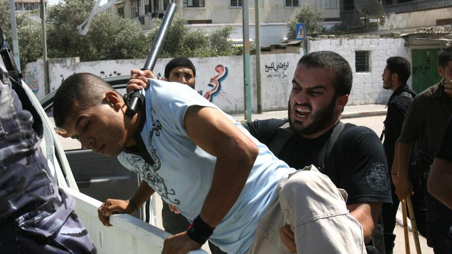 Members of the Hamas security forces arrest a Fatah supporter during a rally in Gaza City on Aug. 31, 2007. Hamas defeated Fatah in heavy fighting in Gaza in June 2007.