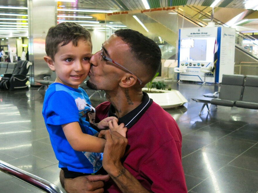 Naser al-Shimary, deported this year to Iraq from the U.S., greets his four-year-old son Vincent at Baghdad international airport. Shimary had lived in the U.S. since he was five years old. He agreed to be deported under a practice halted by a U.S. court this summer.