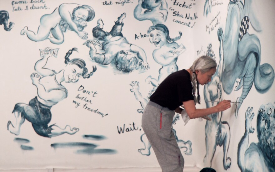 Noriko Shinohara, known to friends and audiences alike as Cutie, paints sprawling comic-style narratives on the walls of the galleries where she's invited to exhibit. They chronicle the adventures of a couple called Bullie and Cutie, who may or may not be reflections of her and her husband.