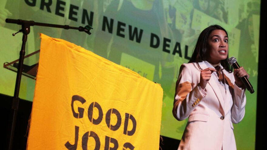 """Rep. Alexandria Ocasio-Cortez, D-N.Y., speaks during a rally at Howard University on Monday. The Sunrise Movement held an event for the final stop of the """"Road to a Green New Deal"""" tour to """"explore what the pain of the climate crisis looks like in D.C. and for the country and what the promise of the Green New Deal means."""""""
