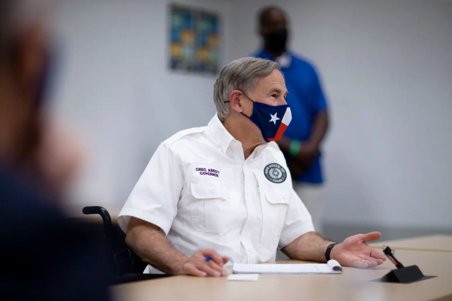 Texas Gov. Greg Abbott meets with local leaders in El Paso last month to discuss the coronavirus situation. At an event Thursday, he proposed enhancing certain penalties for crimes related to protests.