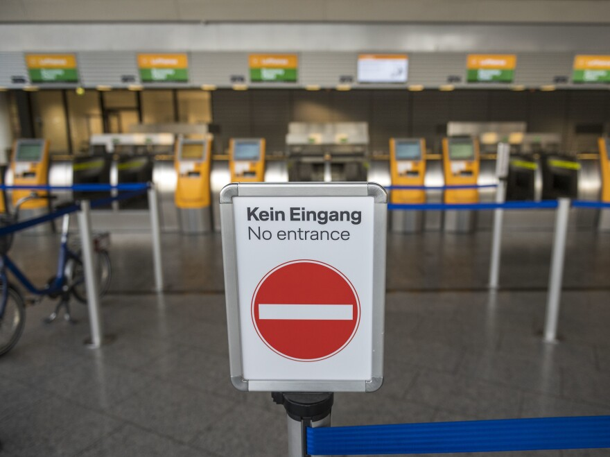 Check-in lines are empty at Frankfurt Airport as airlines are affected by travel bans related to the spread of the coronavirus on Monday.