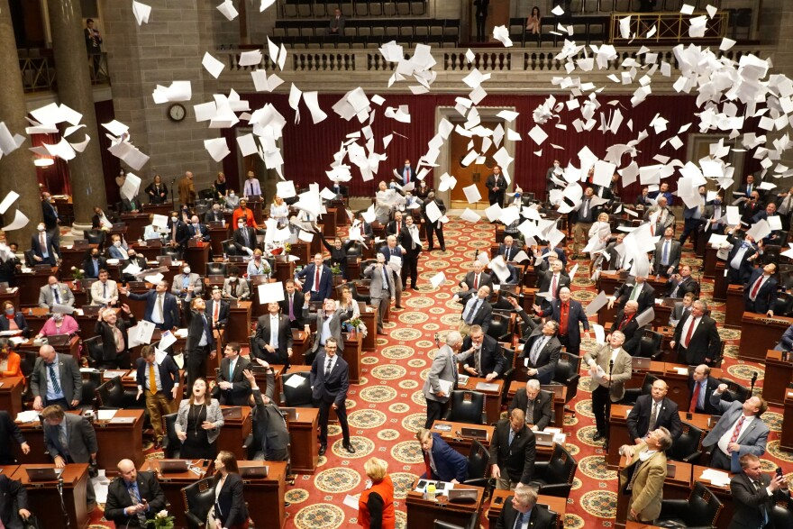 Lawmakers throw paper in the air on May 15, 2020, to celebrate the end of the 2020 Missouri legislative session.