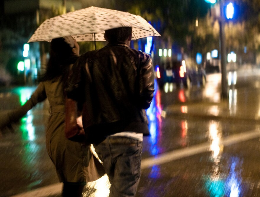 couple running in the rain - By Caleb Miller.jpg
