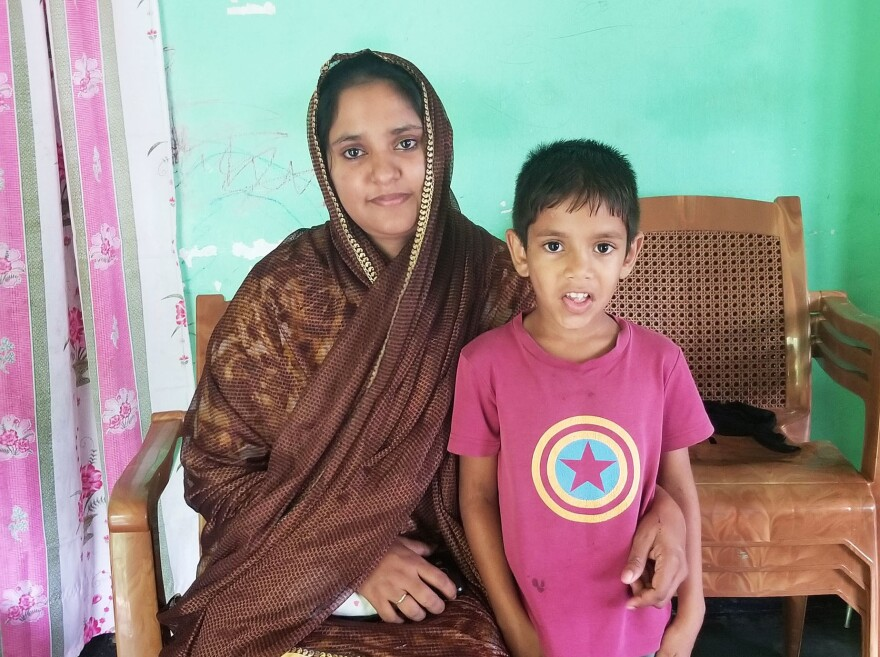 Fatima Jannath and her son Yusef sit in their home in Mawanella, Sri Lanka. Jannath's husband Mohammad Taslim was shot in the head after he tried to warn authorities about radicalization in their Muslim community. Suicide bombers killed more than 250 people on Easter this year.