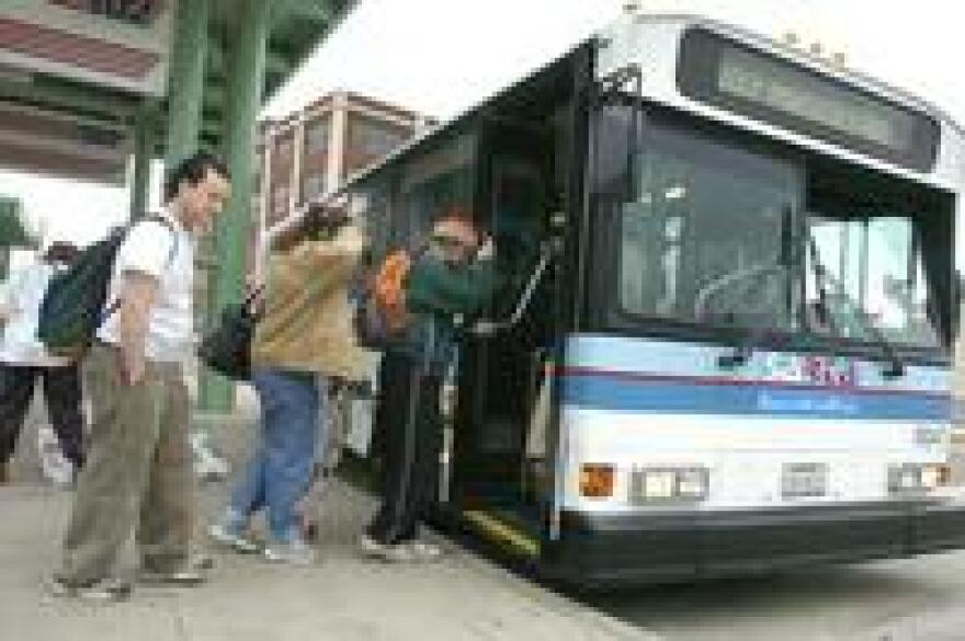 Passengers boarding a SARTA bus in Canton