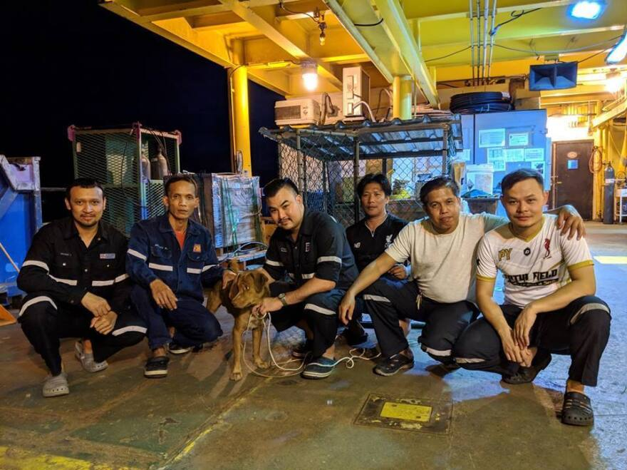 Boonrod poses with oil rig workers in the Gulf of Thailand.