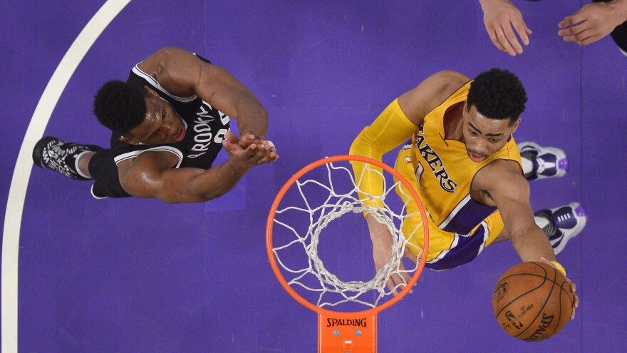 Los Angeles Lakers guard D'Angelo Russell (right) shoots as Brooklyn Nets forward Thaddeus Young leaps for the block during a game in March in Los Angeles.