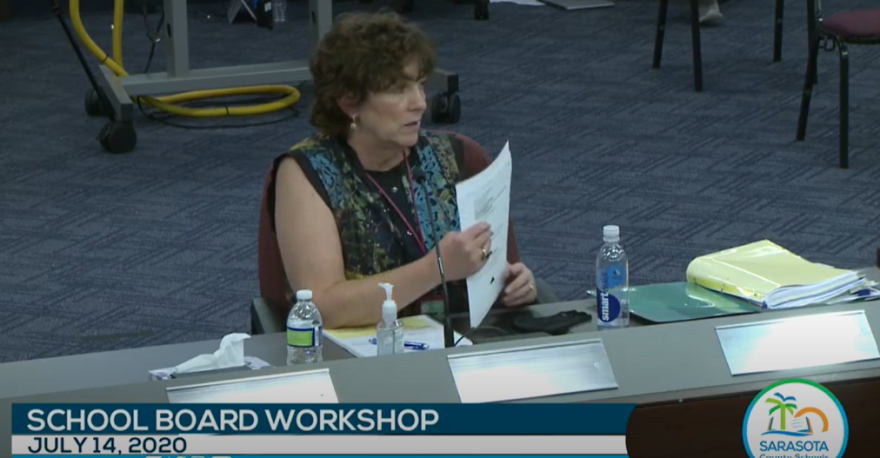 Sarasota Schools chief academic officer Laura Kingsley holds a white paper as she speaks at a school board meeting