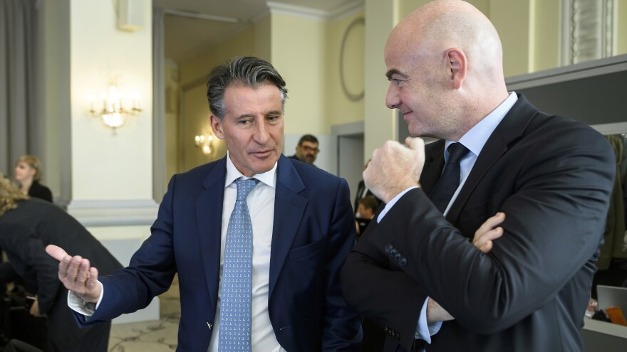 IAAF President Sebastian Coe, left, speaks with FIFA President Gianni Infantino at the opening of an Olympic Summit in Lausanne, Switzerland, Saturday. Olympic sports leaders are discussing how to improve a global anti-doping system amid the fallout of a Russian state-backed cheating scandal.