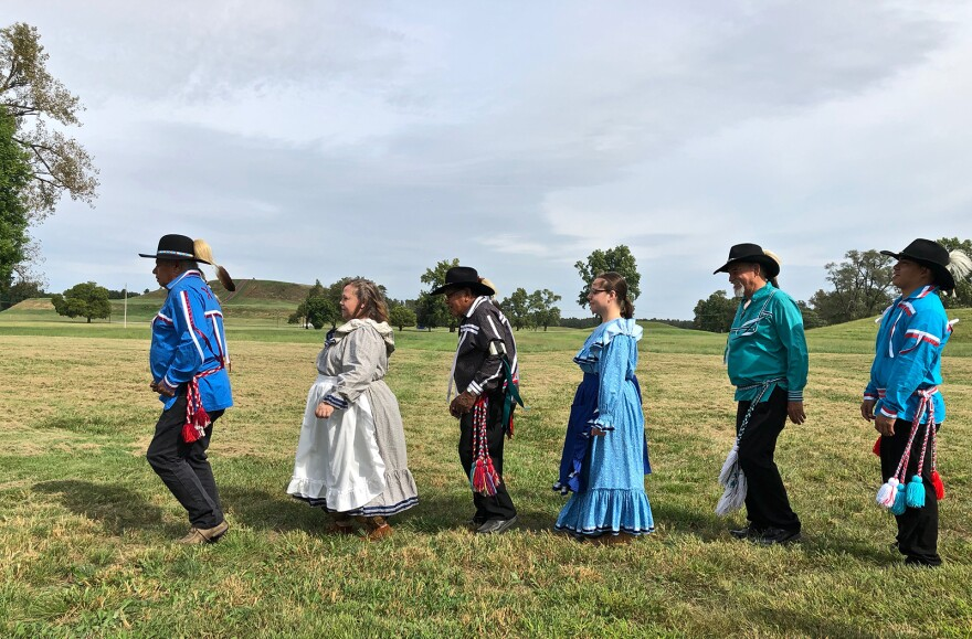 Members of the Chickasaw Nation Dance Troupe demonstrate stomp dance at Cahokia Mounds in Collinsville on Sept. 21. The tribe traces its ancestry to the ancient Mississippians who built the mounds 1,000 years ago.