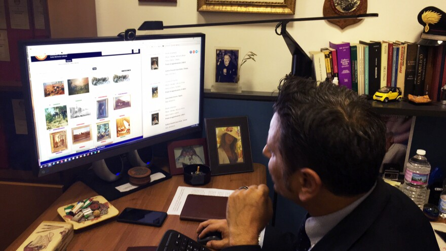 Lt. Francesco Ficarella searches the art squad's Leonardo database.