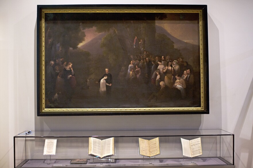 Beneath a mid-19th century painting, the museum displays manuscripts from early American writers, highlighting their Scriptural references.