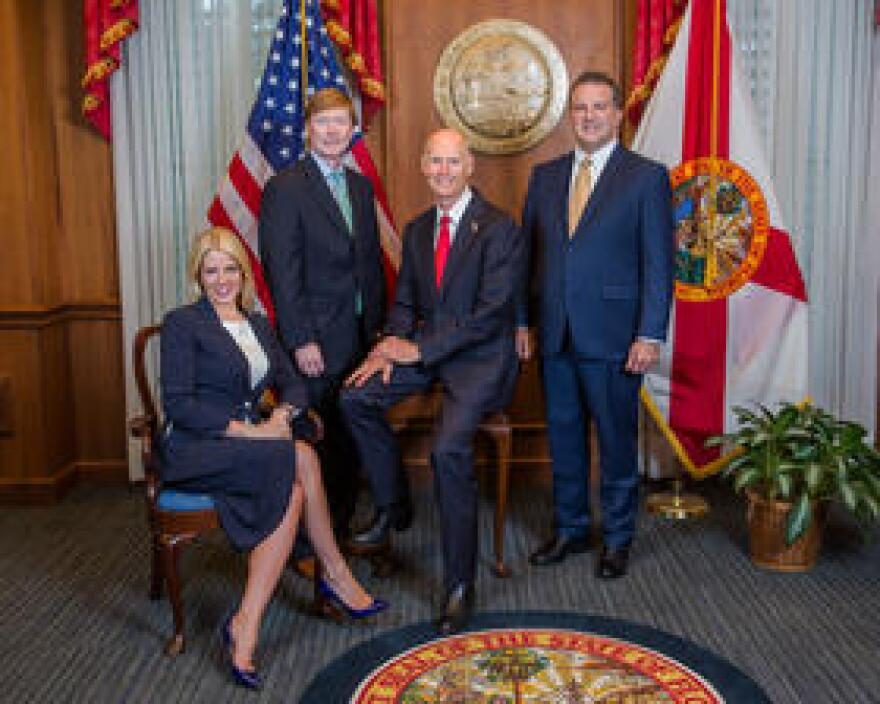 Attorney General Pam Bondi (left) and Governor Rick Scott (third from left) spoke about an Alachua County emergency declaration after the Florida Cabinet meeting Tuesday.