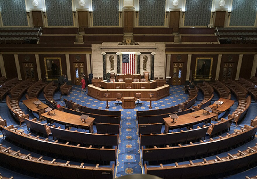 In this file photo from Jan. 3, 2019, the House of Representatives chamber is seen on the first day of the 116th Congress. The coronavirus pandemic is raising the issue of whether there should be remote voting to enable lawmakers to cast votes without all lawmakers needing to return to Washington.