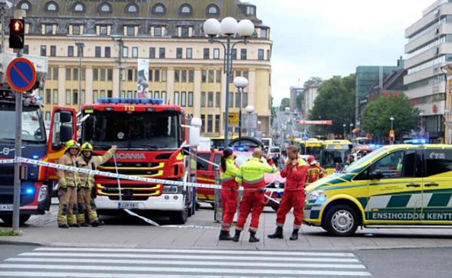 Police officers and rescuers in the Finnish city of Turku after several people were stabbed on Friday.