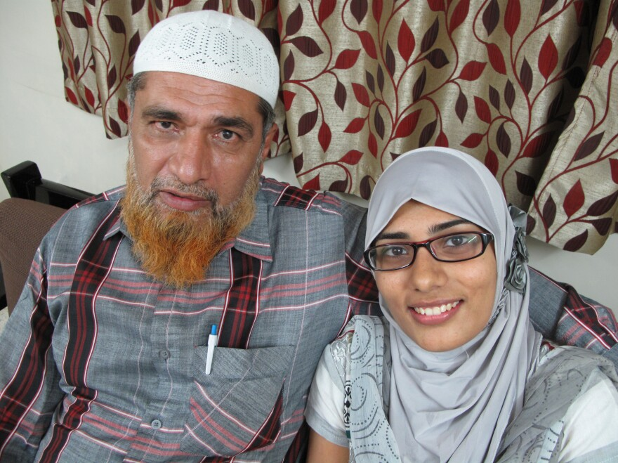 "Shaken by the reaction to his daughter's Facebook post, Farooq Dhada (shown here with Shaheen) says in India, freedom of speech ""exists only on paper."""