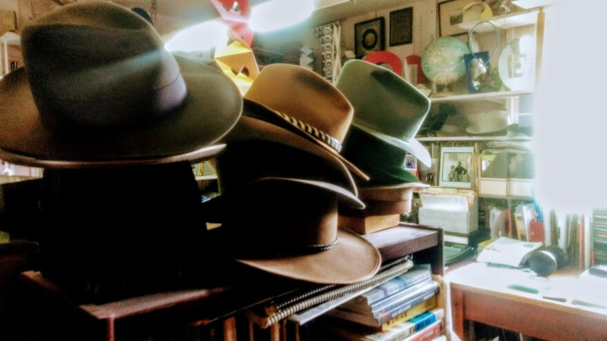 Wittenberg University as Costume Shop Manager and Designer Debbie Henderson studies and collects men's hats.