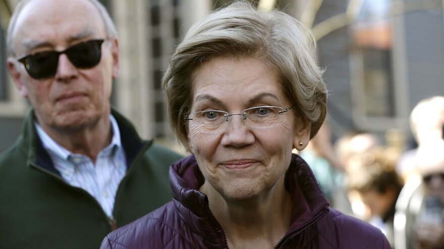 Sen. Elizabeth Warren, D-Mass., speaks outside her home in Cambridge, Mass., after she dropped out of the Democratic presidential race on Thursday.