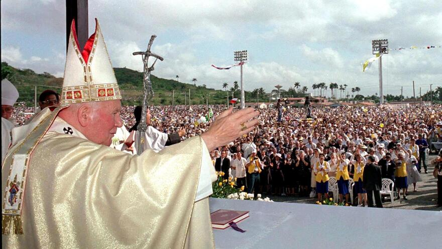 Pope John Paul II stands before worshipers gathered at the Mass in Santa Clara, Cuba, in January 1998. It was the first of four Masses to be celebrated by John Paul II during his five-day visit to the island.
