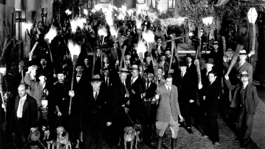 Angry villagers — like these, from James Whale's classic 1931 film version of <em>Frankenstein</em>.