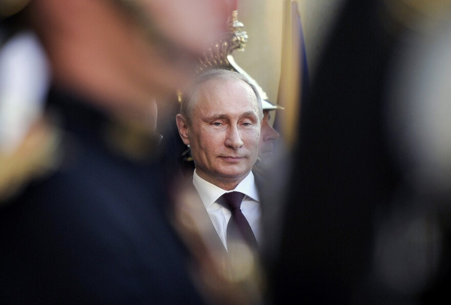 Russian President Vladimir Putin arrives at France's Elysee Palace in Paris in June for talks with French President Francois Hollande. Putin and far-right groups in Europe have been increasingly supportive of each other.