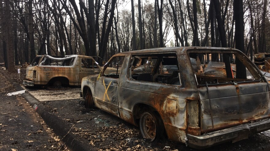 Burned out cars remain stranded in the driveway of a home destroyed by November's Camp Fire. Clean up is just beginning in the town where over 14,000 homes were incinerated. PG&E is under investigation for possibly starting the blaze.