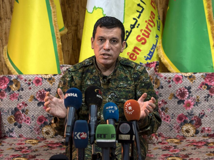 Mazloum Abdi, commander-in-chief of the Syrian Democratic Forces speaks to reporters near the northeastern Syrian Hassakeh province on Thursday.