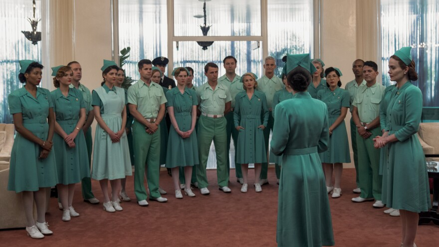 The staff assembles in front of Nurse Bucket (Judy Davis) in <em>Ratched</em>.