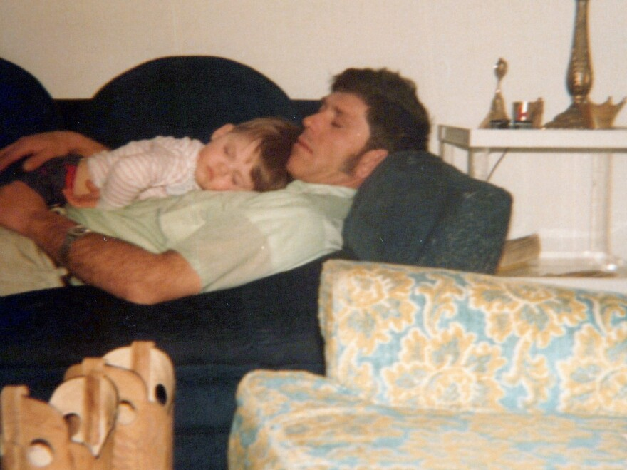 A 1979 photo shows Courtney Farr sleeping on his father's chest when he was a young boy.