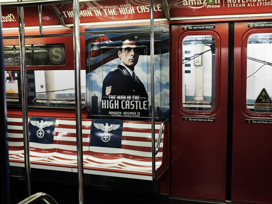 A New York City subway car is covered in Nazi imagery to promote the new Amazon television series <em>The Man in the High Castle. </em>In this photo, the Nazi eagle appears on the American flag where the stars should be.