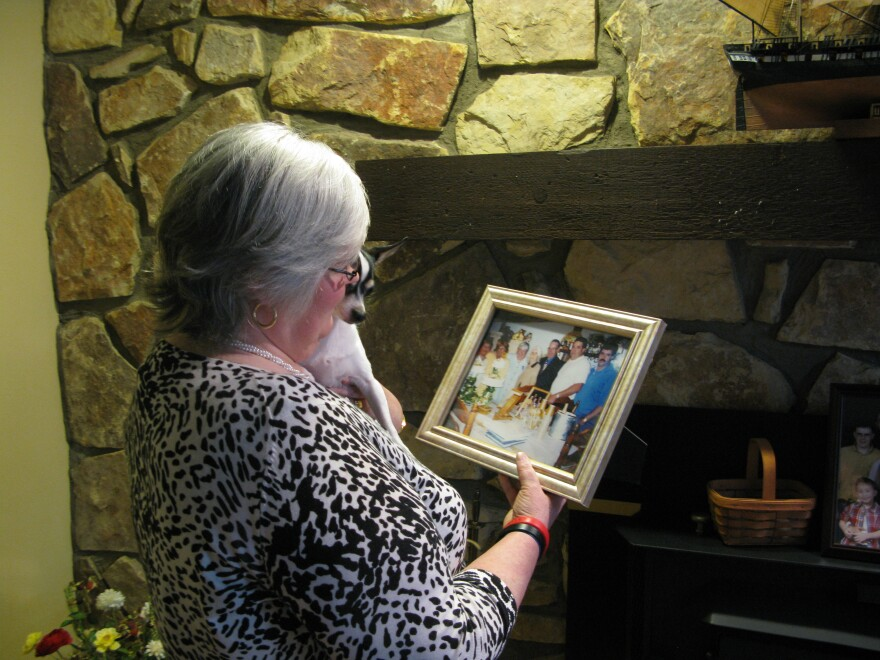 Judy Jones Petersen with a treasured photo of her family. After the Upper Big Branch mine blast, she had to wait four days to learn the fate of her brother.