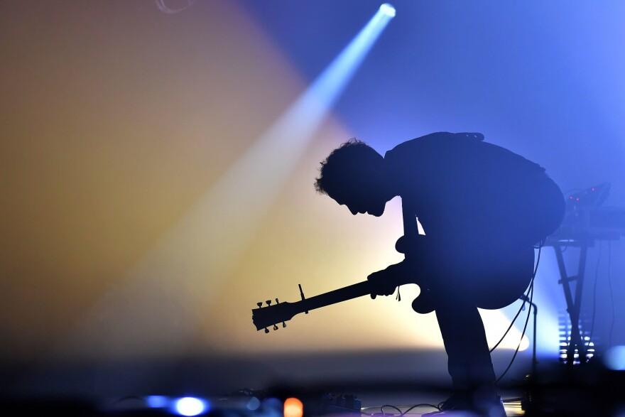 A guitarist preforms. (Loic Venance/AFP via Getty Images)