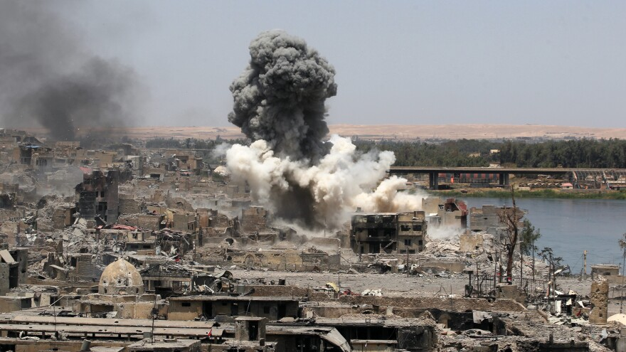 The U.S.-led Operation Inherent Resolve coalition says it currently has nearly 700 open cases of strikes that were reported to have killed civilians. A coalition airstrike is seen here in Mosul, Iraq, this past July.