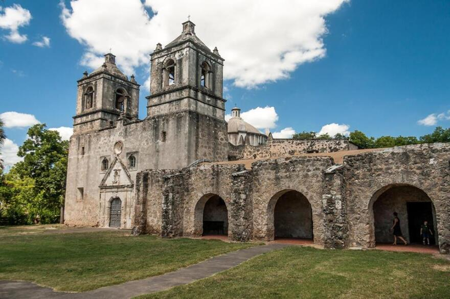 Mission Concepción is located three miles south of downtown San Antonio. Colorful geometric designs used to cover its surface, but as an unrestored building, they have faded.