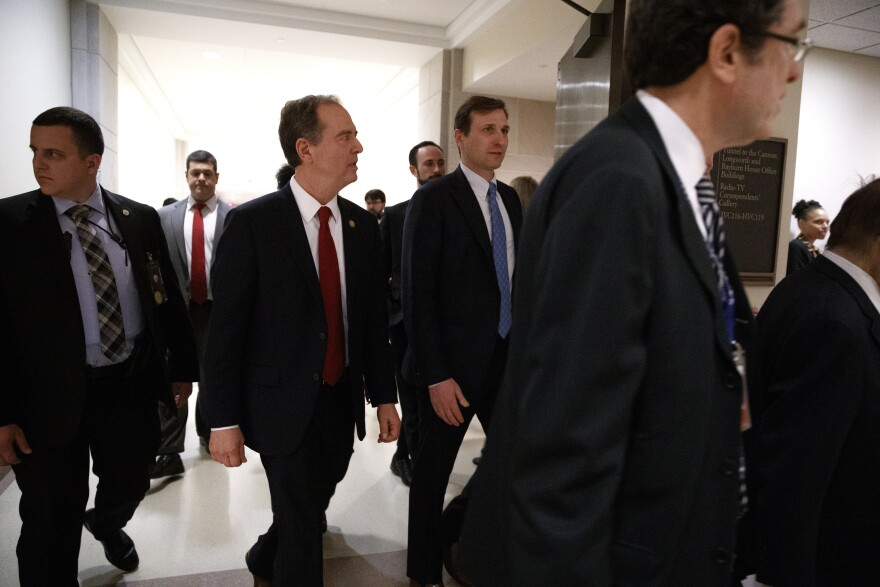 Rep. Adam Schiff (second from left), the lead House Democratic impeachment manager, leaves a news conference on Capitol Hill on Tuesday.
