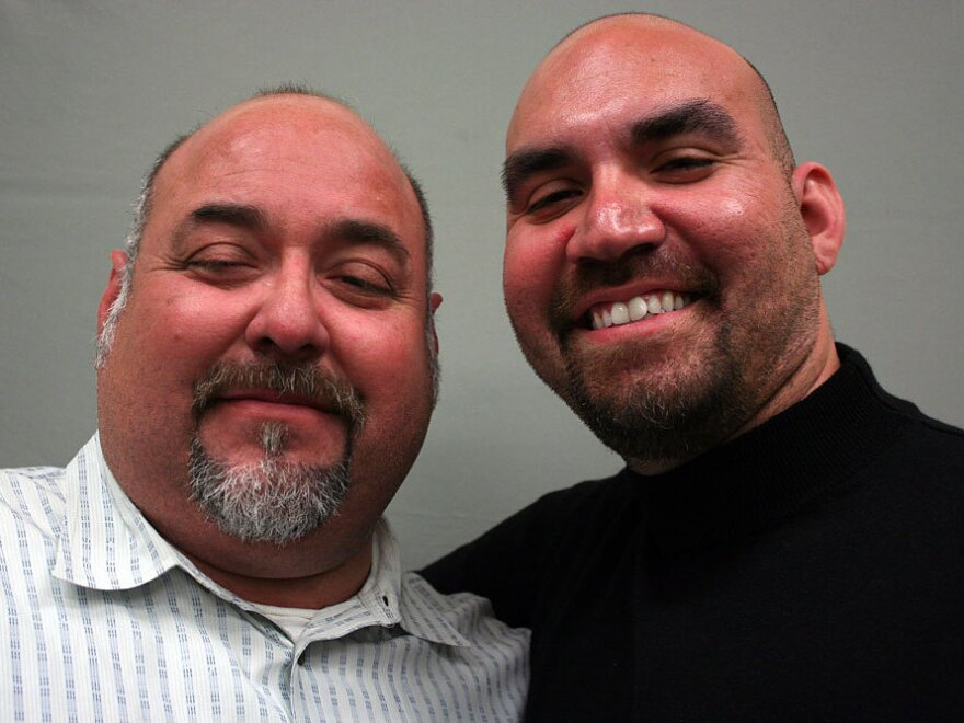 Ricardo Isaias Zavala (left) talked about his grandfather Vicente Domingo Villa with his son, Ricardo Javier Zavala, at StoryCorps in Austin, Texas.
