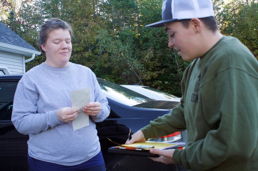 Tucker of Equality Maine talks with a supporter in Dexter, Maine, who bought a bumper sticker.