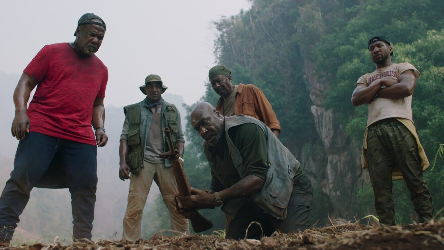 Delroy Lindo (center) stars in <em>Da 5 Bloods</em> as Paul, a Vietnam veteran whose conservative politics are driven by a sense of betrayal
