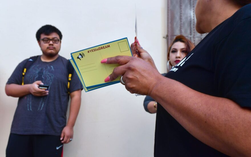 Volunteers with cards to be filled out and sent to members of the House of Representatives as Deferred Action for Childhood Arrivals (DACA) recipients wait in line at the Coalition for Humane Immigrant Rights office in Los Angeles on Sept. 30, 2017. Volunteer lawyers were on hand to offer assistance on the final weekend before the Oct. 5, 2017, deadline when more than 154,000 DACA recipients must renew their work permits before the program ends March 5, 2018. (Frederic J. Brown/AFP/Getty Images)