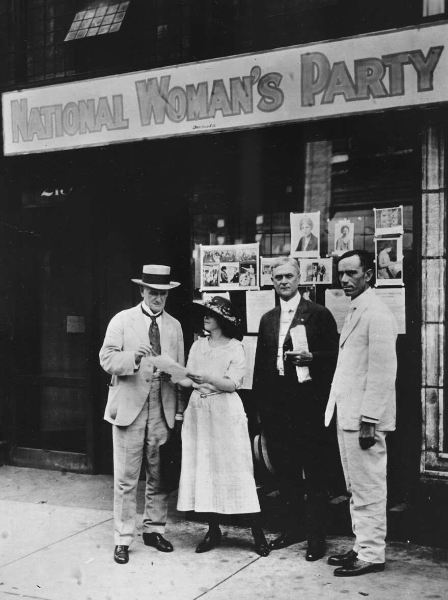 Anita Pollitzer, legislative secretary of the National Woman's Party, meets with Tennessee Sen. John C. Houk (left), Knoxville Mayor E.W. Neal and state Rep. R.I. Johnson — who were suffrage supporters — in front of the Nashville headquarters in August 1920.