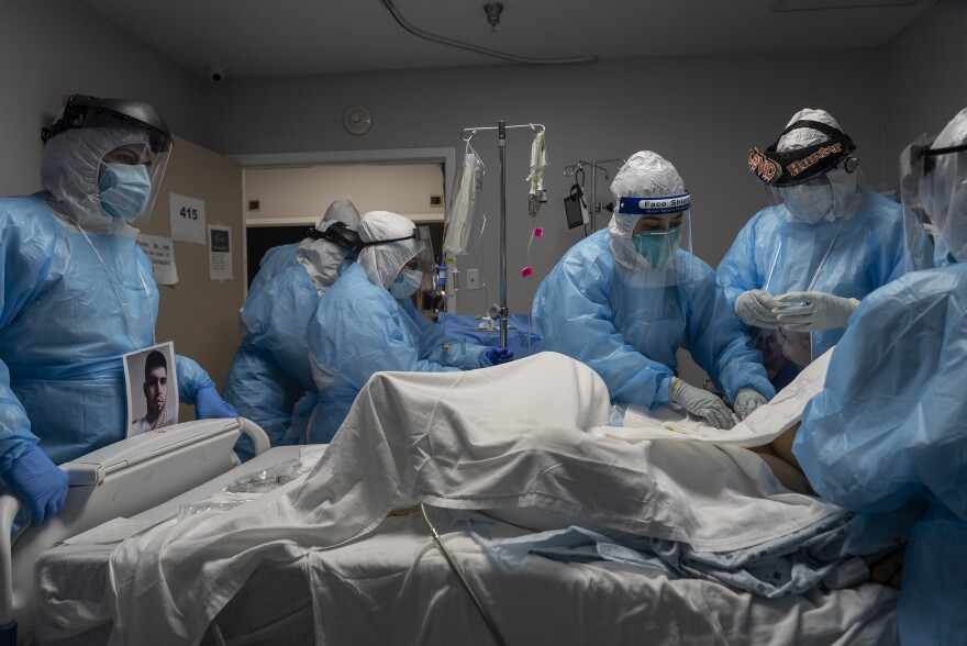 Medical staff members treat a patient seriously ill with COVID-19 in the intensive care unit of United Memorial Medical Center on Oct. 31 in Houston. Experts say immunizing health workers first, once a COVID-19 vaccine's available, is best to curb deaths and stop transmission.