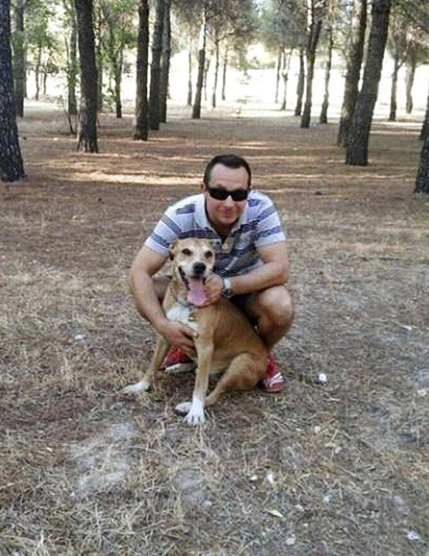 The dog Excalibur belongs to Teresa Ramos, the Ebola-afflicted nurse in Spain. Here, the pet poses with her husband, Javier Limon.