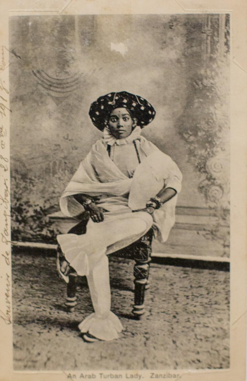 <em>An Arab Turban Lady, Zanzibar</em> by A.C. Gomes & Son. Photograph taken before 1900; postcard printed before 1914.