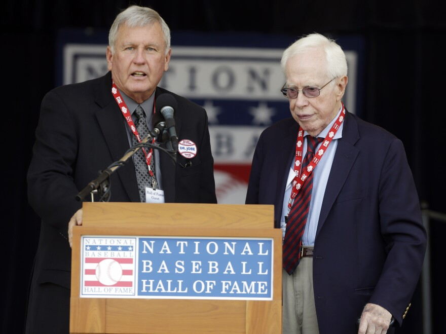 "Retired baseball pitcher Tommy John, left, and Dr. Frank Jobe at the National Baseball Hall of Fame in July 2013. <a href=""http://baseballhall.org/news/press-releases/baseball-hall-fame-recognize-feature-film-%2742%27-alongside-dr-frank-jobe-during"">Jobe was honored</a> for the pioneering surgery he first performed on John's elbow in 1974."
